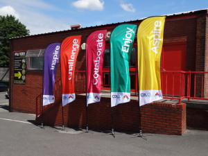 Brightly coloured 3.5 metre banner flags help emphasise key events and promotions